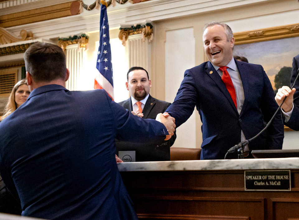 Photo - President Pro Temper Greg Treat, right, greets Gov. Kevin Stitt before he delivers his State of the State Address in the House Chambers of the Oklahoma House of Representative in Oklahoma City, Okla. on Monday, Feb. 3, 2020.  [Chris Landsberger/The Oklahoman]