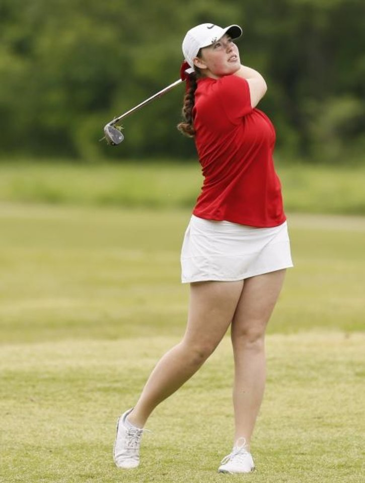 Photo -  Yukon's Alyssa Wilson hits a shot from the fairway during the first day of the Class 6A girls high school golf state championship at Earlywine Golf Club in Oklahoma City on Wednesday. [Nate Billings/The Oklahoman]