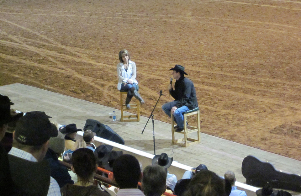 Photo - Susie McEntire Eaton is shown with Trevor Brazile at Cowboy Church before the final round of the 2011 Timed Event Championship of the World. Brazile has won 16 Professional Rodeo Cowboys Association world champion titles.  Photo Provided - Photo Provided