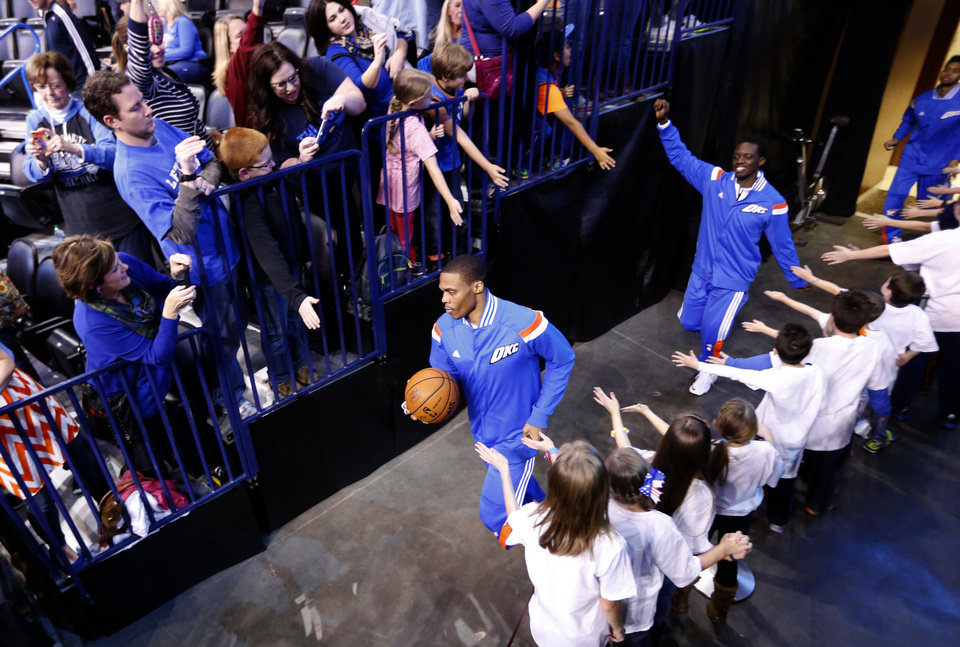 Photo - Oklahoma City's Russell Westbrook (0) runs on to the court before the NBA game between the Oklahoma City Thunder and the New York Knicks at the Chesapeake Energy Arena in Oklahoma City, Friday, Nov. 28, 2014.  Photo by Sarah Phipps, The Oklahoman