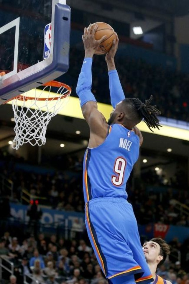 Photo - Oklahoma City's Nerlens Noel (9) goes up for a dunk during the NBA basketball game between the Oklahoma City Thunder and the Phoenix Suns at the Chesapeake Energy Arena in Oklahoma City , Friday, Dec. 20, 2019.   [Sarah Phipps/The Oklahoman]