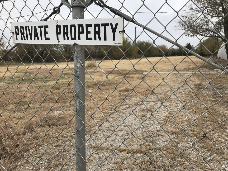 Photo -  A private property sign hangs on a fence at 8828 SE 29 St. in Midwest City. [Photo by Justin Wingerter, The Oklahoman]