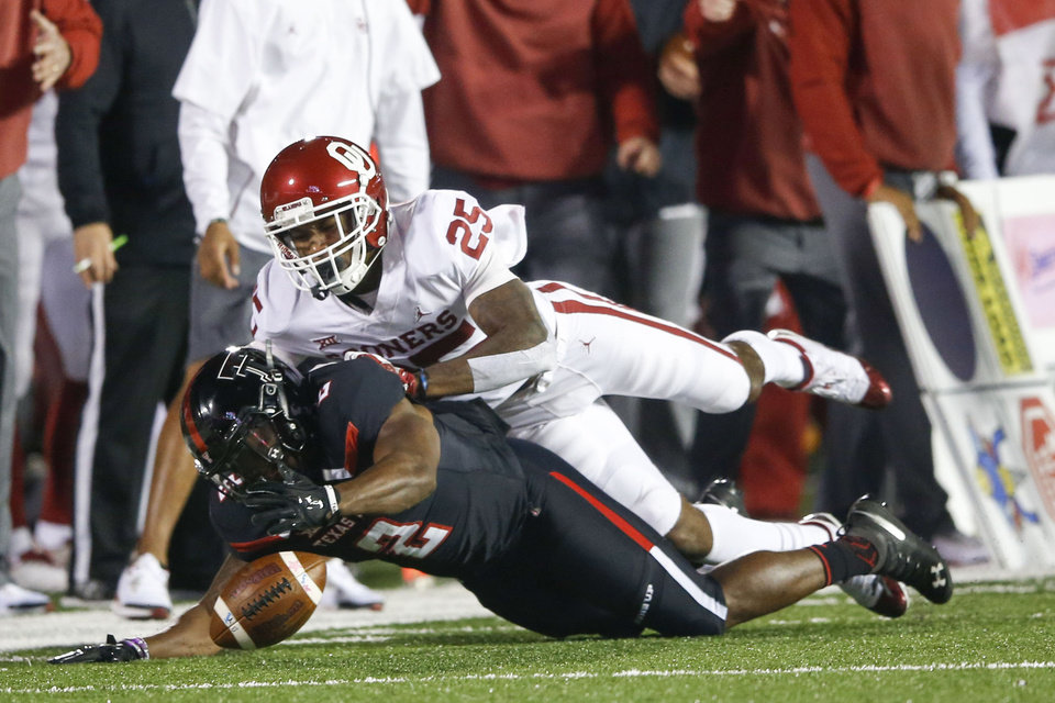 Photo - Texas Tech Red Raiders running back Demarcus Felton (2) and Oklahoma Sooners defensive back Justin Broiles (25) dive for a loose ball during the NCAA football game between the Texas Tech Red Raiders and the Oklahoma Sooners at Jones AT&T Stadium in Lubbock, Texas on Saturday, November 03, 2018. IAN MAULE/Tulsa World