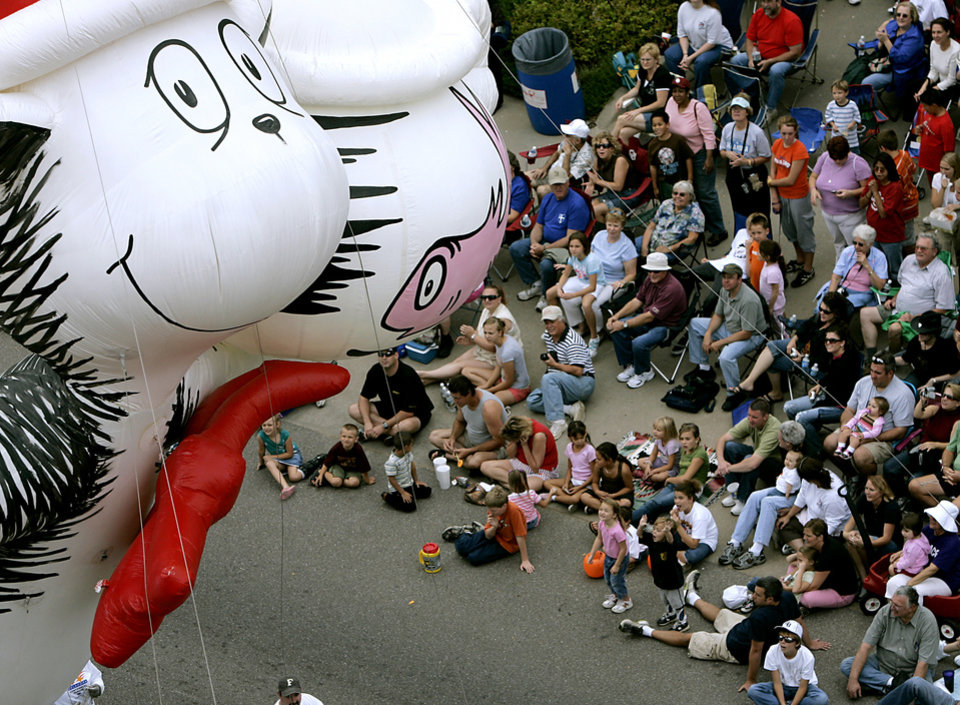 Photo - The Cat in the Hat floats by the crowd during the Oklahoma Centennial Parade in Oklahoma City on Sunday, Oct. 14, 2007. By John Clanton, The Oklahoman