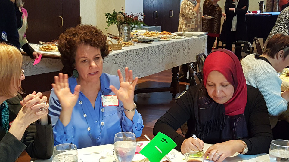 Photo -  Susan Donchin and Zena Attia sit at a table during the Diversi-Tea event. [Photo by Carla Hinton, The Oklahoman]
