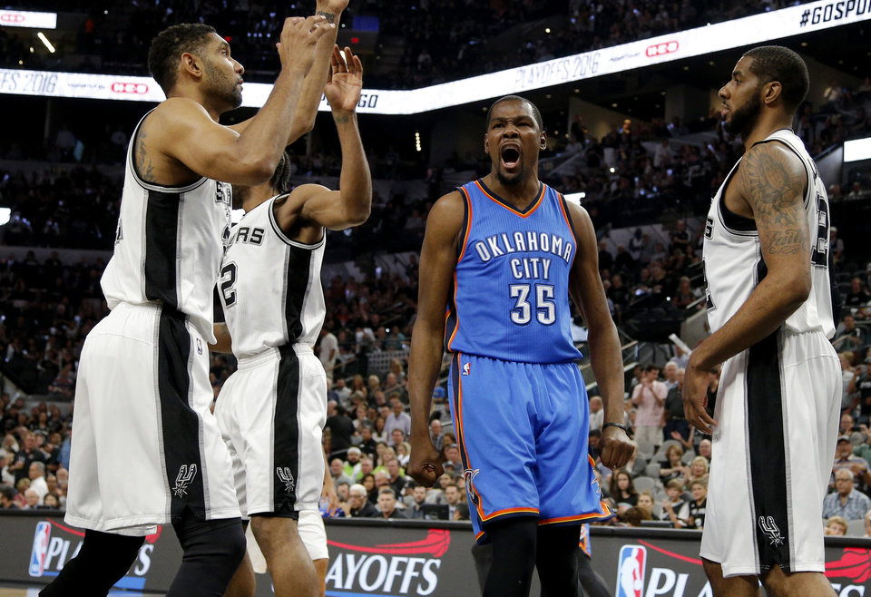 Photo - Oklahoma City's Kevin Durant (35) reacts after a basket between San Antonio's Tim Duncan (21) and LaMarcus Aldridge during Game 5 of the second-round series between the Oklahoma City Thunder and the San Antonio Spurs in the NBA playoffs at the AT&T Center in San Antonio, Tuesday, May 10, 2016. Photo by Bryan Terry, The Oklahoman
