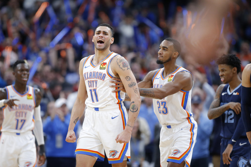 Photo - Oklahoma City's Abdel Nader (11) and Terrance Ferguson (23) celebrate after a Memphis turnover during and NBA basketball game between the Oklahoma City Thunder and the Memphis Grizzlies at Chesapeake Energy Arena in Oklahoma City, Wednesday, Dec. 18, 2019. Oklahoma City won 126-122. [Bryan Terry/The Oklahoman]