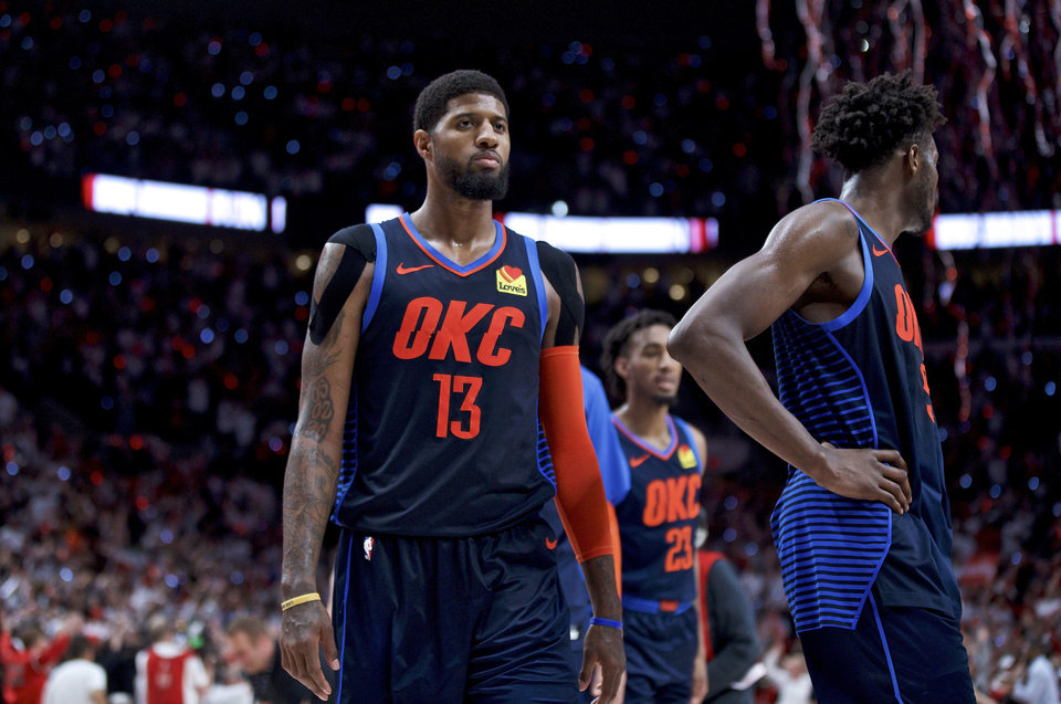 Photo - Oklahoma City Thunder forward Paul George, left, and forward Jerami Grant walk off the court after losing to the Portland Trail Blazers in Game 5 of an NBA basketball first-round playoff series, Tuesday, April 23, 2019, in Portland, Ore. The Trail Blazers won 118-115. (AP Photo/Craig Mitchelldyer)