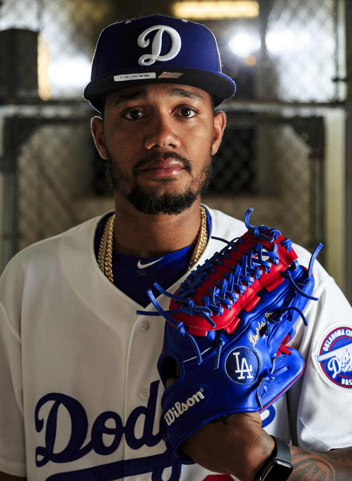 Photo - Dennis Santana poses for a photo at the Chickasaw Bricktown Ballpark in Oklahoma City, Okla. on Tuesday, April 2, 2019. The Dodgers will open the season on Thursday against San Antonio.  Photo by Chris Landsberger, The Oklahoman