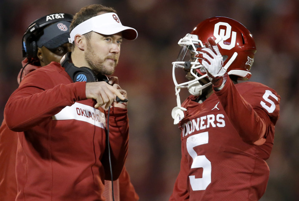 Photo - Oklahoma's Marquise Brown (5) talks with Oklahoma coach Lincoln Riley during a college football game between the University of Oklahoma Sooners (OU) and the Kansas Jayhawks (KU) at Gaylord Family-Oklahoma Memorial Stadium in Norman, Okla., Saturday, Nov. 17, 2018. Photo by Bryan Terry, The Oklahoman