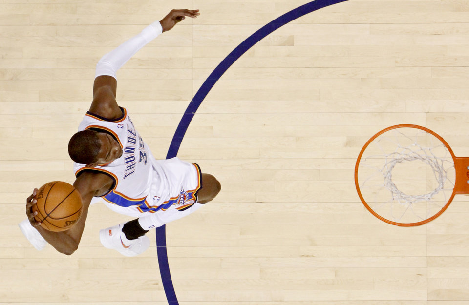 Photo - Oklahoma City's Kevin Durant  dunks the ball during the NBA basketball game between the Los Angeles Lakers and the Oklahoma City Thunder in the first round of the NBA playoffs at the Ford Center in Oklahoma City, Saturday, April 24, 2010. Photo by Bryan Terry, The Oklahoman