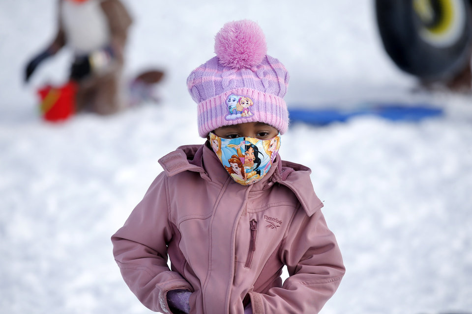 Photo - Kayleigh James, 3, waits to sled on a hill along Hefner Road in Oklahoma City, Wednesday, Feb. 17, 2021. [Sarah Phipps/The Oklahoman]