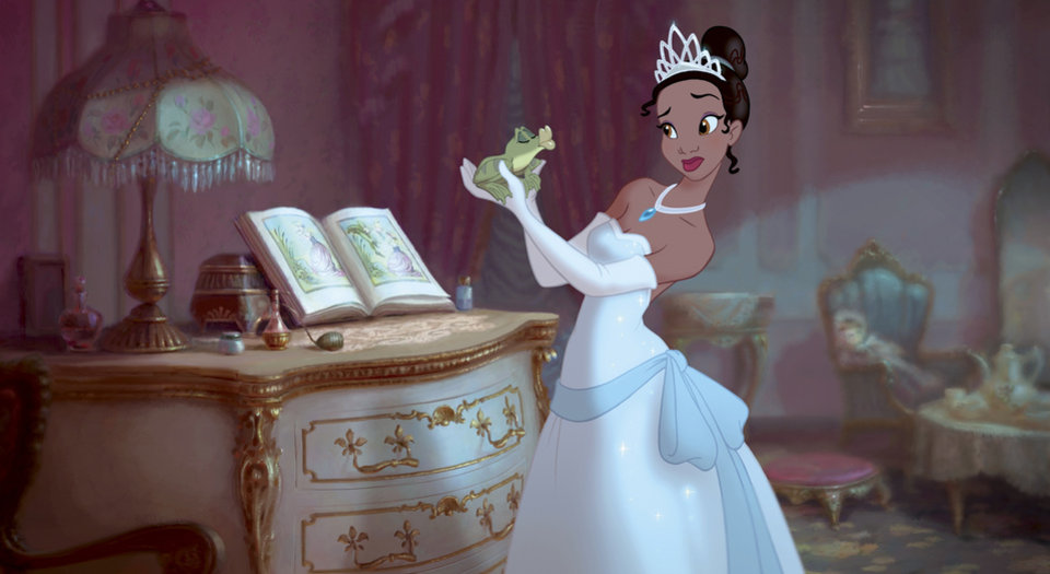 Photo - In this film publicity image released by Disney, Princess Tiana, voiced by Anika Noni Rose, holds Prince Naveen, voiced by Bruno Campos, in a scene from the animated film,