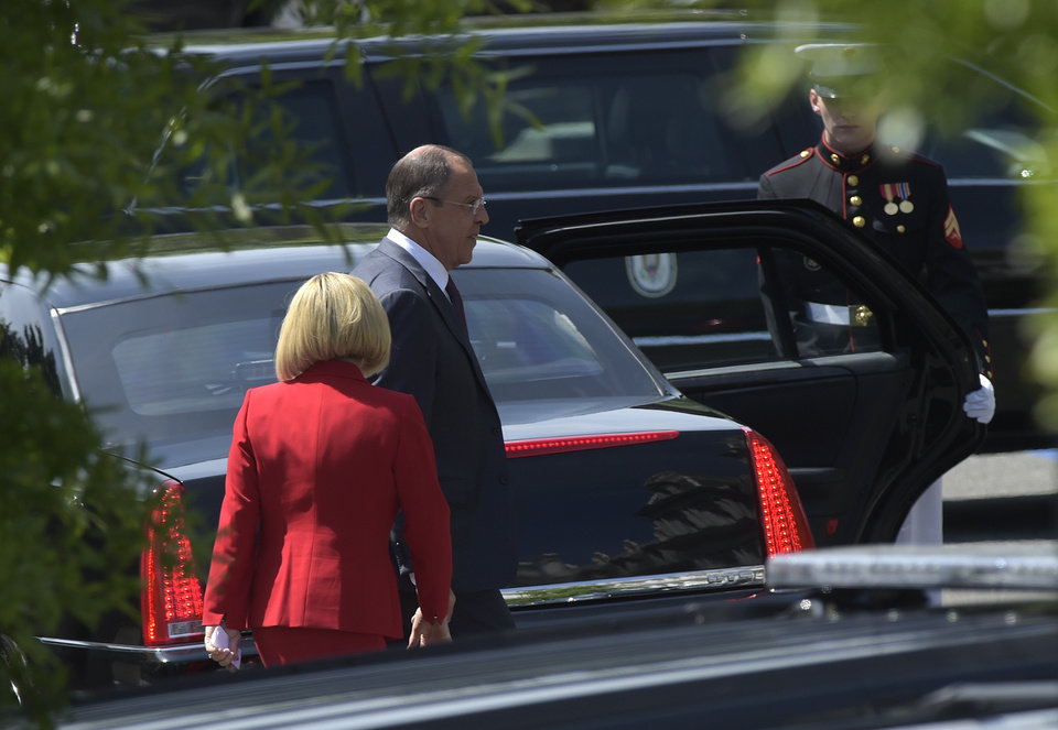 Photo - Russian Foreign Minister Sergey Lavrov walks to his car as he leaves the White House in Washington, Wednesday, May 10, 2017, following a meeting with President Donald Trump. (AP Photo/Susan Walsh)