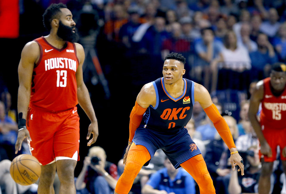 Photo -  Oklahoma City's Russell Westbrook, right, defends Houston's James Harden during Tuesday night's game at Chesapeake Energy Arena.