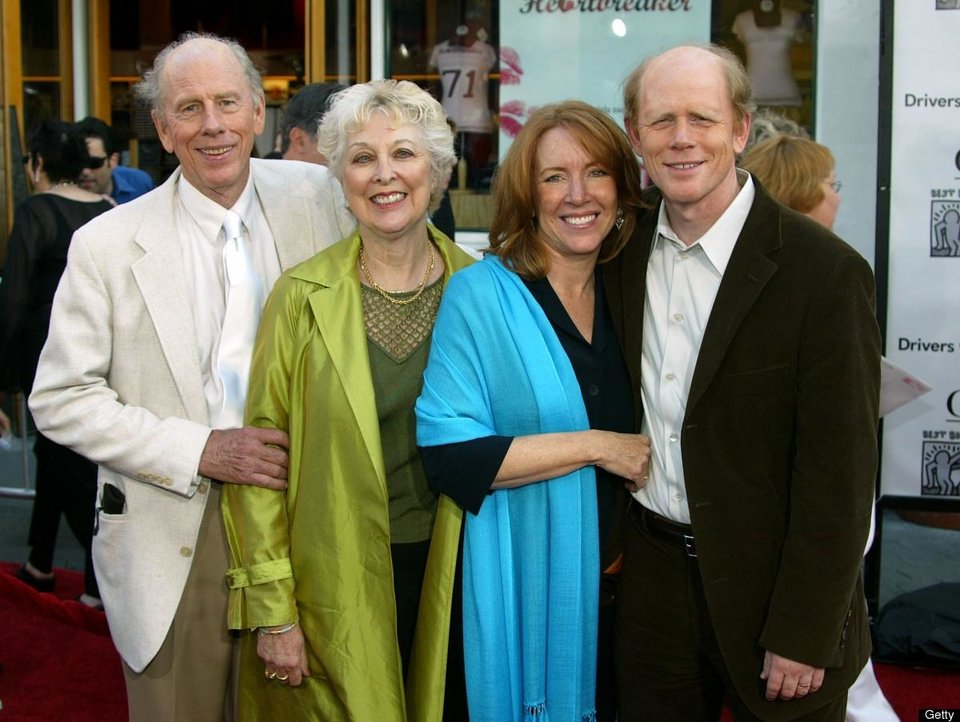 "Photo - From left, Rance Howard and his wife, Judy, and Cheryl Howard and her husband, director Ron Howard, arrive at the ""Cinderella Man"" premiere in 2005.  Photo provided by Getty Images     -"