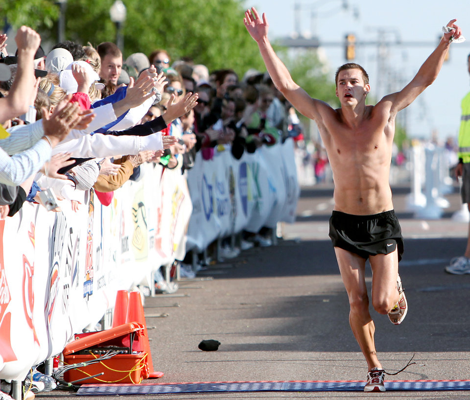 Photo - MAN / MEN / WIN / WINNER / CELEBRATION: First-place male runner Josh Stewart celebrates as he nears the finish line during the Tenth Annual Oklahoma City Memorial Marathon in Oklahoma City on Sunday, April 25, 2010. By John Clanton, The Oklahoman ORG XMIT: KOD