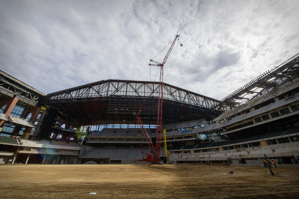 Photo - A view of the field and retractable roof at Globe Life Field in December. The Big 12 baseball tournament will be played in the Texas Rangers' new stadium for three years beginning in 2022. [Jerome Miron/USA TODAY Sports]