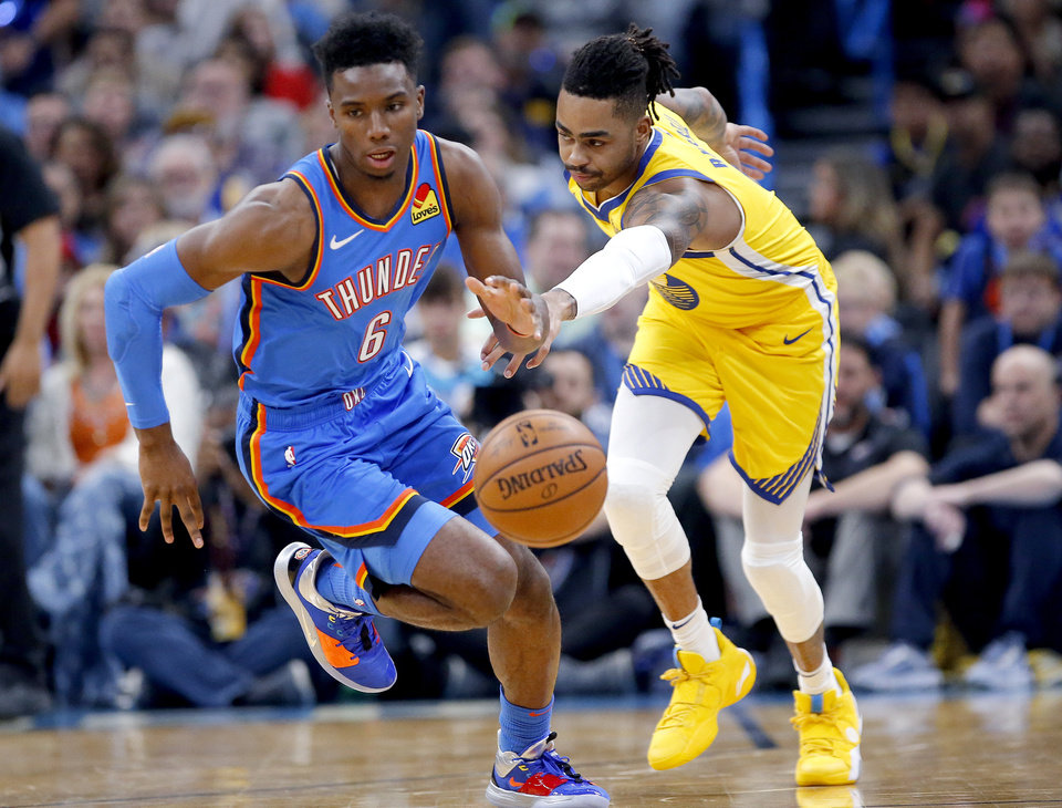 Photo - Hamidou Diallo (6) gets a loose ball from Golden State's D'Angelo Russell (0) during the NBA game between the Oklahoma City Thunder and the Golden State Warriors at Chesapeake Energy Arena,   Saturday, Nov. 9, 2019.  [Sarah Phipps/The Oklahoman]