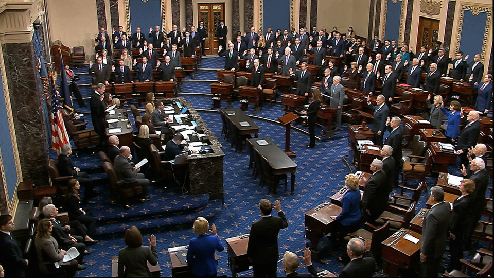 Photo -  In this image from video, presiding officer Supreme Court Chief Justice John Roberts swears in members of the Senate for the impeachment trial against President Donald Trump, Thursday at the U.S. Capitol in Washington. [Senate Television via AP]