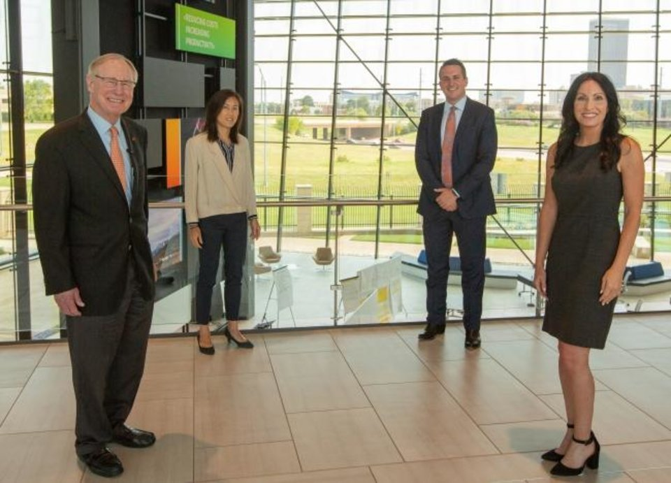 Photo -  Burns Hargis, Oklahoma State University's president, is pictured in the Energy Innovation Center's entrance with Maki Ikeda, the center's director, Taylor Shinn, Baker Hughes' vice president for digital solutions and Katy Boren, CEO of Oklahoma City's Innovation District. [PROVIDED BY BAKER HUGHES]