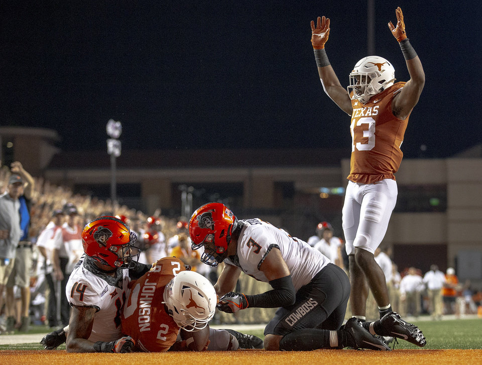 Photo - Texas running back Roschon Johnson (2) scores a two-point conversion against Oklahoma State during an NCAA college football game Saturday, Sept. 21, 2019, in Austin, Texas. (Nick Wagner/Austin American-Statesman via AP)