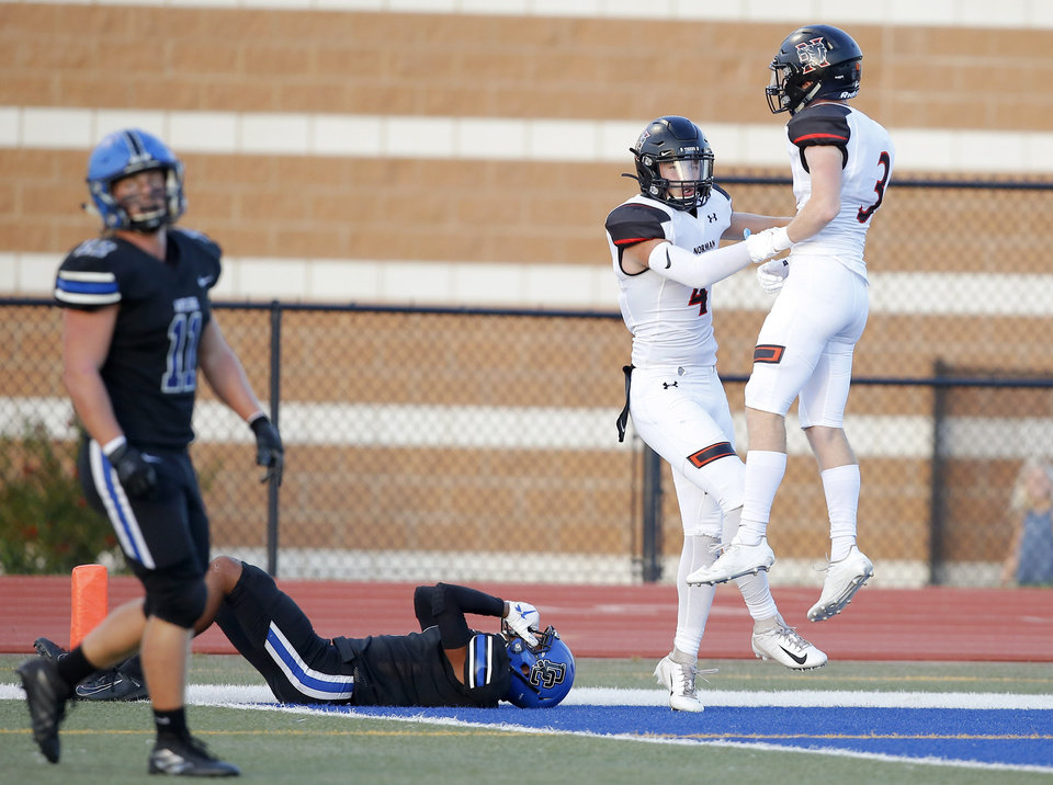 Photo - Norman's Jonah Paden, center, and Kyler Keenan celebrate beside Deer Creek's Jevion Jones during a high school football game between Deer Creek and Norman at Deer Creek High School, Friday, Sept. 13, 2019. [Bryan Terry/The Oklahoman]