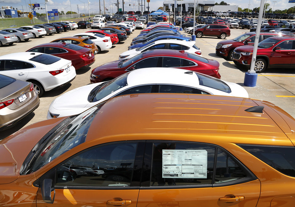 Photo -  Cars on the sales lot of Hudiburg Chevrolet on the Tinker Diaganol in Midwest City, on Monday, Aug. 28, 2017. On Thursday, the Oklahoma Supreme Court upheld a 1.25-percent sales tax on vehicle purchases. Photo by Jim Beckel, The Oklahoman