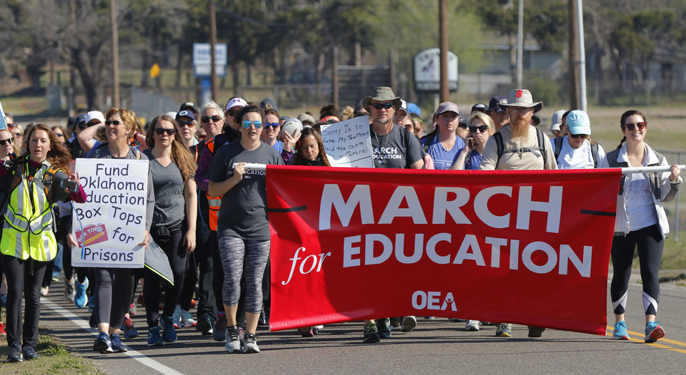 Photo - Teachers from Tulsa and others walk south on Spencer Rd toward NE 36th in the March for Education on the last day of their trek from Tulsa to the Capitol, Tuesday, April 10, 2018. Photo by Doug Hoke, The Oklahoman