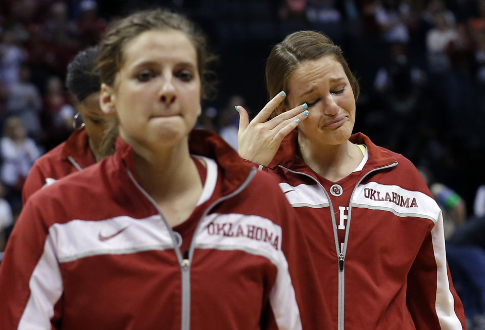 Photo - Oklahoma's Whitney Hand (25) walks off the court following the college basketball game between the University of Oklahoma and the University of Tennessee at the  Oklahoma City Regional for the NCAA women's college basketball tournament at Chesapeake Energy Arena in Oklahoma City, Sunday, March 31, 2013. Photo by Sarah Phipps, The Oklahoman