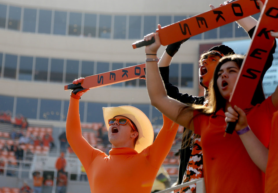 Photo - Oklahoma State fans cheer before the Bedlam college football game between the Oklahoma State Cowboys (OSU) and the Oklahoma Sooners (OU) at Boone Pickens Stadium in Stillwater, Okla., Saturday, Nov. 4, 2017. Photo by Sarah Phipps, The Oklahoman