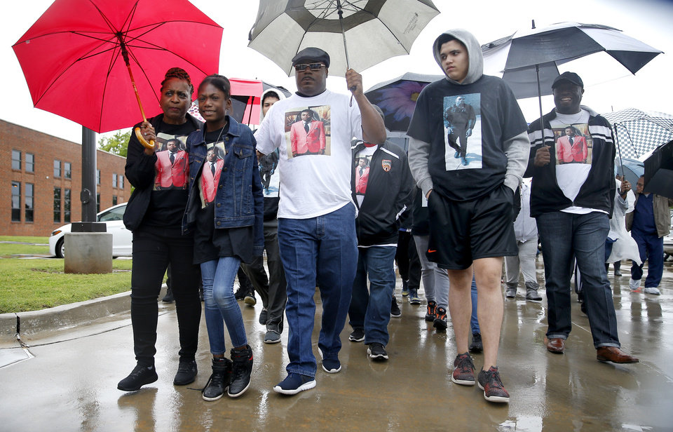 Photo - The family of Isaiah Lewis march to the Edmond Police Department during a Black Lives Matter protest rally honoring the Life of Isaiah Lewis in Edmond, Okla.,  Friday, May 3, 2019. [Sarah Phipps/The Oklahoman]