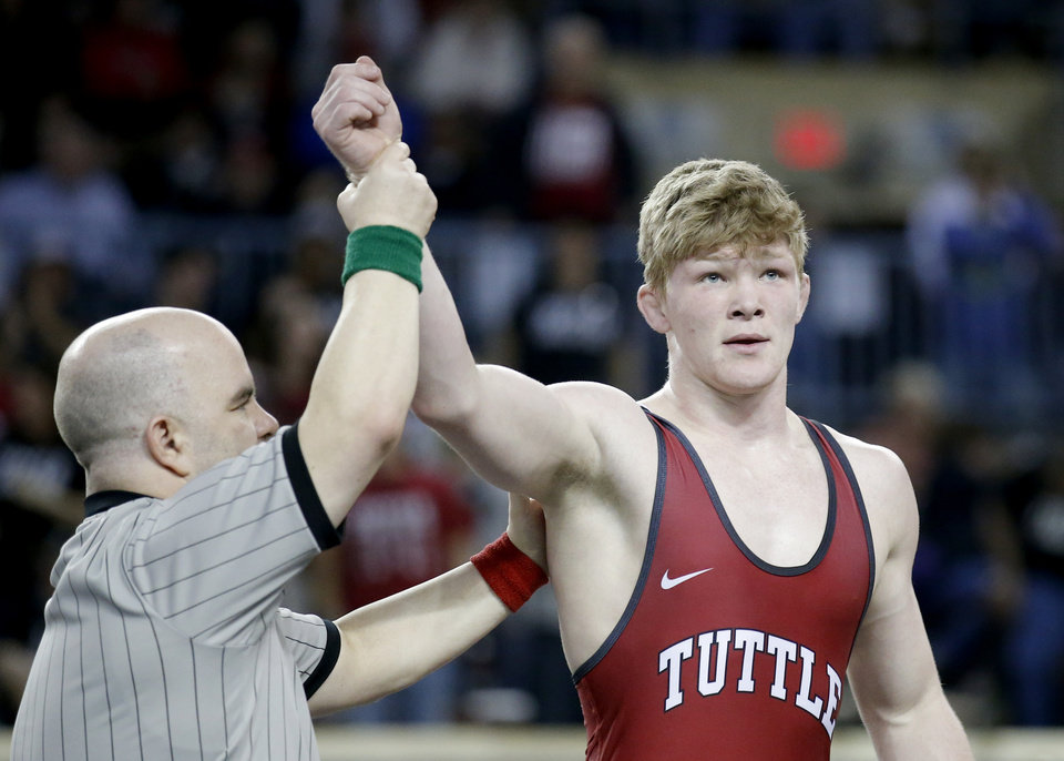 Photo - Tuttle's Dustin Plott celebrates his win over Tecumseh's Tyler Bingman in the 170-pound match during the Oklahoma high school state championships at the State Fair Arena in Oklahoma City,  Saturday, Feb. 23, 2019. Photo by Sarah Phipps, The Oklahoman