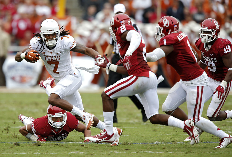 Photo - Texas' Marcus Johnson (7) runs past the Oklahoma defense during the college football game between the University of Oklahoma Sooners (OU) and the University of Texas Longhorns (UT) during the Red River Showdown at the Cotton bowl in Dallas, Texas on Saturday, Oct. 11, 2014. Photo by Chris Landsberger, The Oklahoman