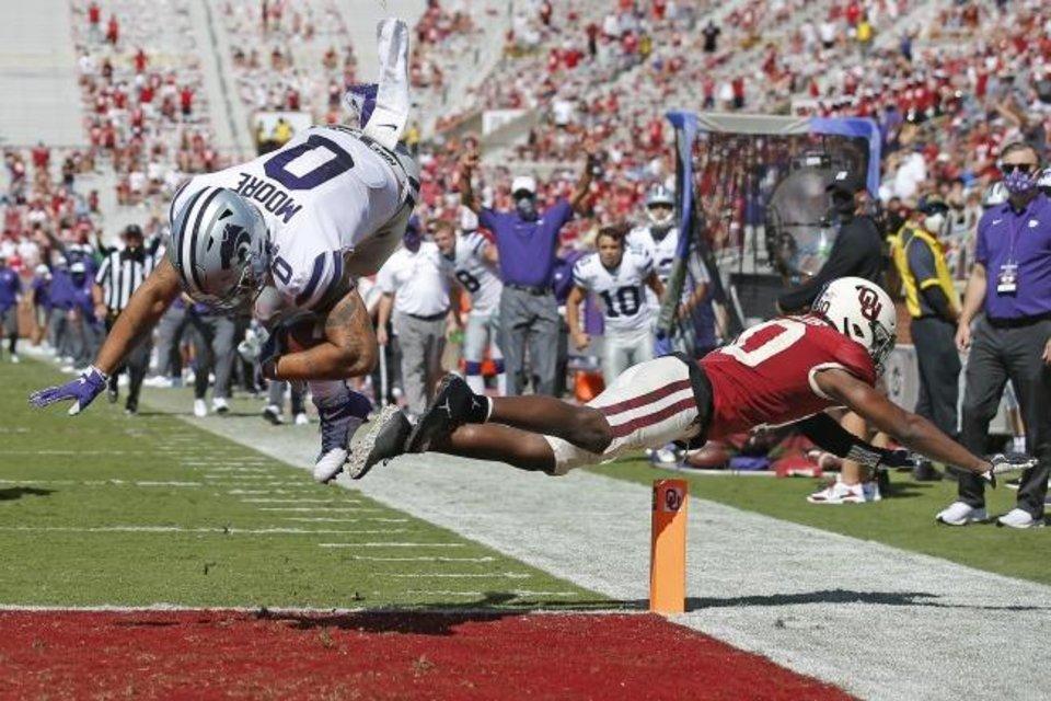 Photo -  Kansas State's Briley Moore (0) leaps over OU's Pat Fields (10) during a play that was called back due to a Wildcat penalty Saturday. [Bryan Terry/The Oklahoman]
