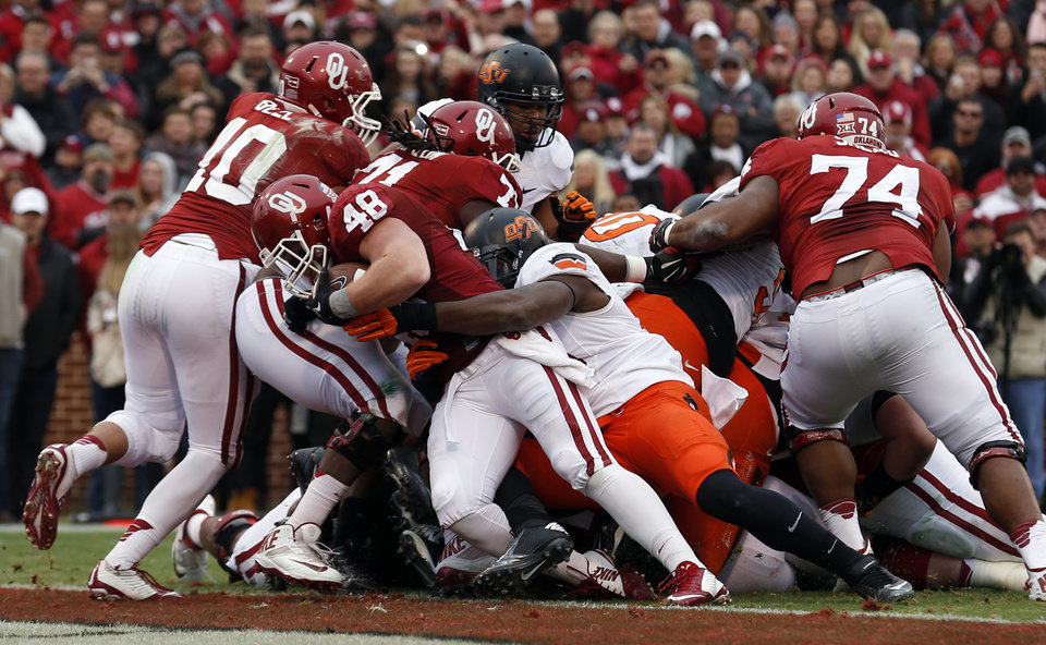Photo - Oklahoma's Aaron Ripkowski (48) scores a touchdown during the Bedlam college football game between the University of Oklahoma Sooners (OU) and the Oklahoma State Cowboys (OSU) at Gaylord Family-Oklahoma Memorial Stadium in Norman, Okla., Saturday, Dec. 6, 2014. Photo by Sarah Phipps, The Oklahoman