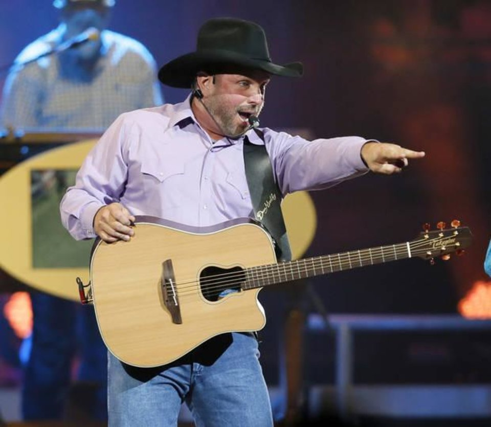 Photo - Garth Brooks performs during his 7 p.m. show at the Chesapeake Energy Arena in Oklahoma City, Friday, July 14, 2017. Photo by Nate Billings, The Oklahoman Archives