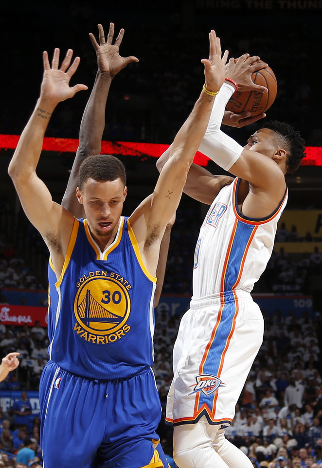 Photo - Oklahoma City's Russell Westbrook (0) is fouled as he shoot beside Golden State's Stephen Curry (30) during Game 3 of the Western Conference finals in the NBA playoffs between the Oklahoma City Thunder and the Golden State Warriors at Chesapeake Energy Arena in Oklahoma City, Sunday, May 22, 2016. Photo by Bryan Terry, The Oklahoman