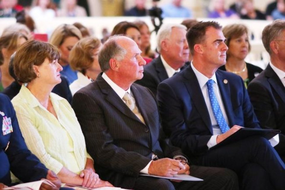 Photo -  Joyce and the Rev. John Stitt and their son, Gov. Kevin Stitt, listen to music on Thursday during the 2019 National Day of Prayer service at the State Capito. [Doug Hoke/The Oklahoman]