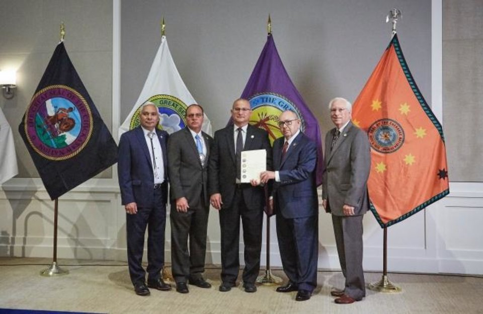 Photo -  Leaders of the Five Civilized Tribes pose with a resolution rejecting Gov. Kevin Stitt's call to renegotiate Oklahoma's tribal gaming compacts. From left to right, Muscogee (Creek) Nation Principal Chief James R. Floyd, Choctaw Nation Chief Gary Batton, Seminole Nation Chief Greg. P. Chilcoat, Chickasaw Nation Governor Bill Anoatubby and Cherokee Nation Principal Chief Bill John Baker stand together at a meeting of the Inter-Tribal Council of the Five Civilized Tribes. [Provided photo]