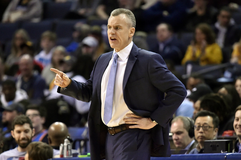 Photo - Oklahoma City Thunder coach Billy Donovan calls to players during the first half of the team's NBA basketball game against the Memphis Grizzlies on Monday, March 25, 2019, in Memphis, Tenn. (AP Photo/Brandon Dill)