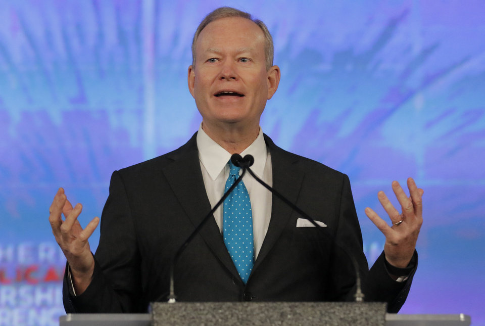 Photo - Mayor Mick Cornett delivers remarks at the Southern Republican Leadership Conference at the Cox Convention Center in Oklahoma City, Friday May, 21 2015. Photo By Steve Gooch, The Oklahoman