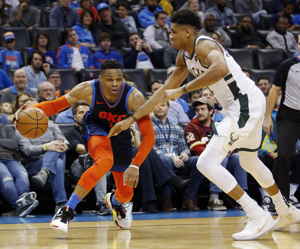 Photo - Oklahoma City's Russell Westbrook (0) handles the ball as Milwaukee's Giannis Antetokounmpo (34) defends in the fourth quarter during an NBA basketball game between the Milwaukee Bucks and the Oklahoma City Thunder at Chesapeake Energy Arena in Oklahoma City, Sunday, Jan. 27, 2019. Oklahoma City won 118-112. Photo by Nate Billings, The Oklahoman