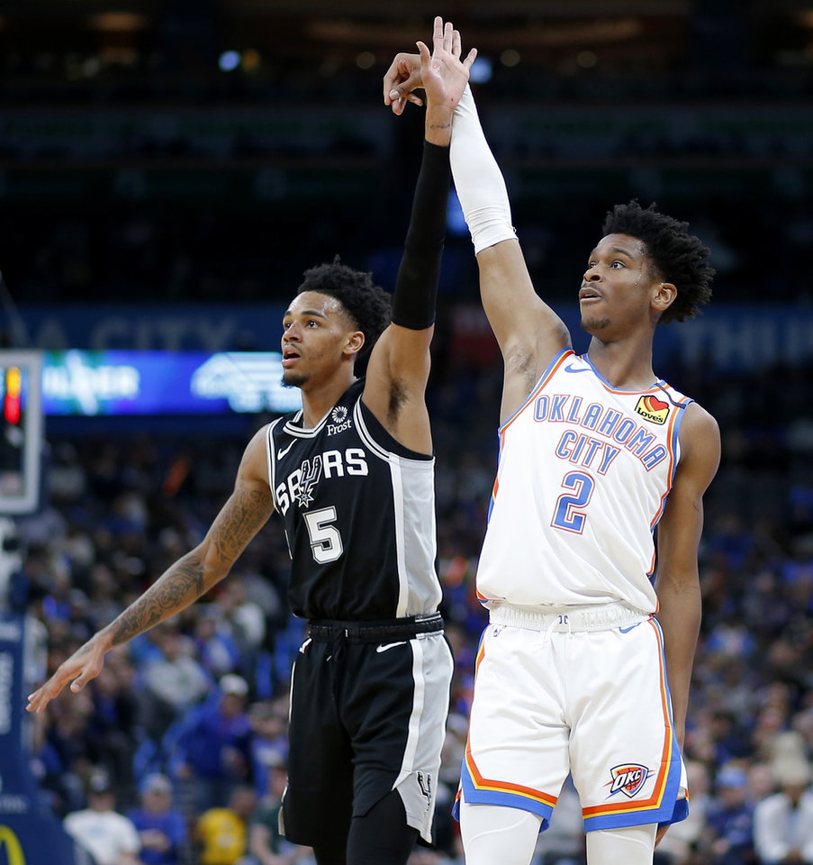 Photo - Oklahoma City's Shai Gilgeous-Alexander (2) watches his shot go in beside San Antonio's Dejounte Murray (5) during an NBA basketball game between the Oklahoma City Thunder and the San Antonio Spurs at Chesapeake Energy Arena in Oklahoma City, Tuesday, Feb. 11, 2020. San Antonio won 114-106. [Bryan Terry/The Oklahoman]