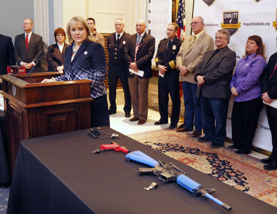 Photo -  Oklahoma Governor Mary Fallin speaks during a Project Childsafe Communities announcement Wednesday on responsible firearms ownership at the State Capitol. [Photo by Paul Hellstern, The Oklahoman]