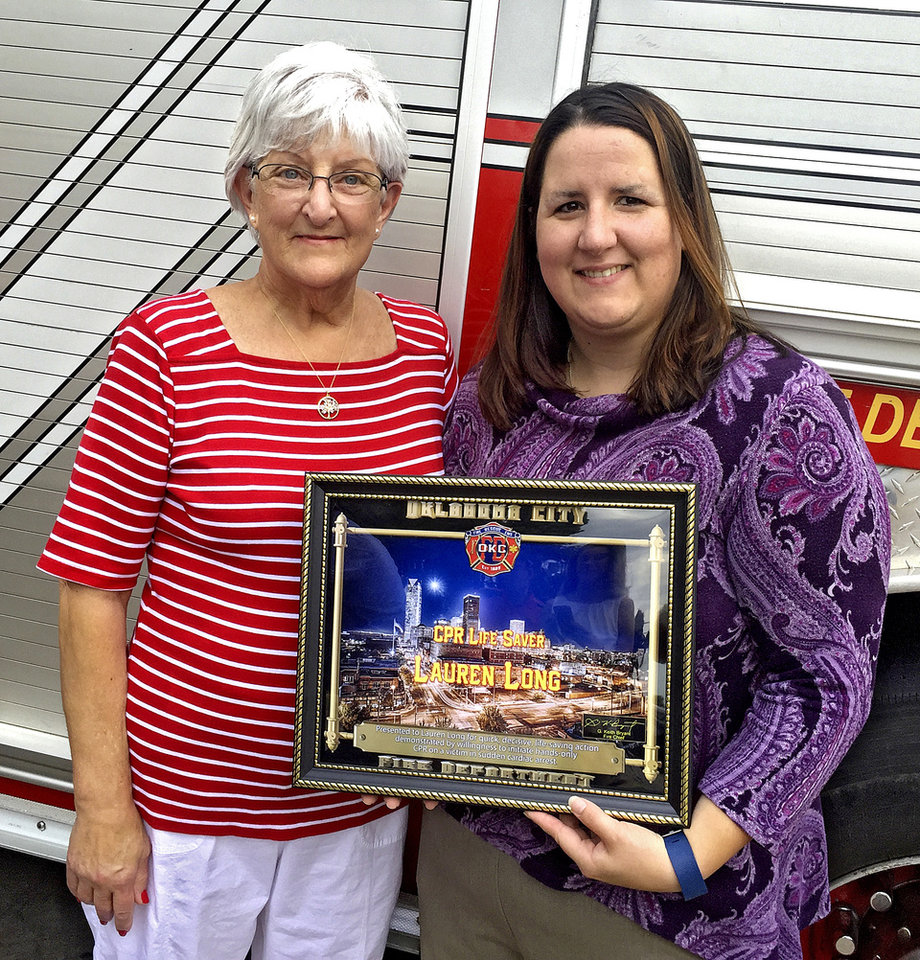Photo - Mary Long, 65, on the left on Thursday, July 7, 2016 poses for a photo with her daughter Lauren Long who used CPR to save Mary after a heart attack in northwest Oklahoma City. Lauren learned CPR offered by The Oklahoma City fire department for the Memorial Marathon. 