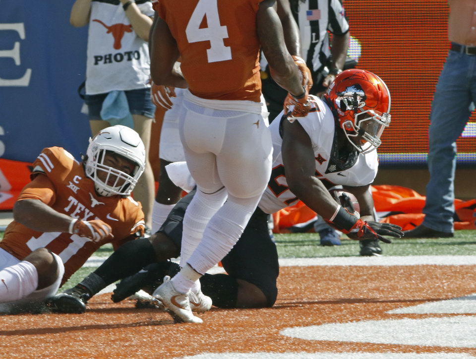 Photo - Oklahoma State running back J.D. King, right, scores a touchdown against Texas during the first half of an NCAA college football game, Saturday, Oct. 21, 2017, in Austin, Texas. (AP Photo/Michael Thomas)