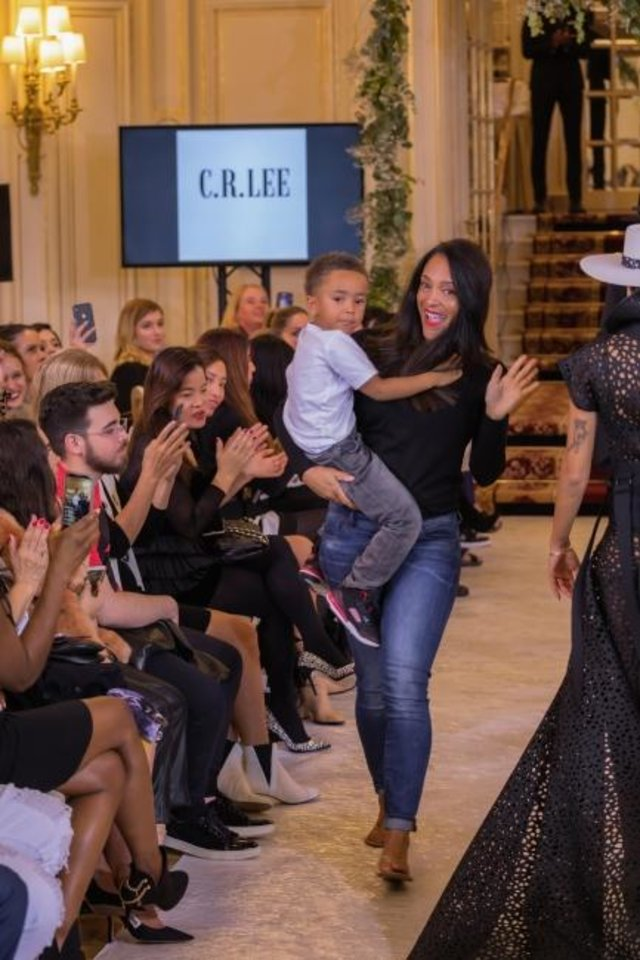 Photo -  Designer Crystal Lee and her son, Rhyme, on a runway in Paris during Paris Fashion Week. [Rohit Verma and Radhakrishna KV photo]