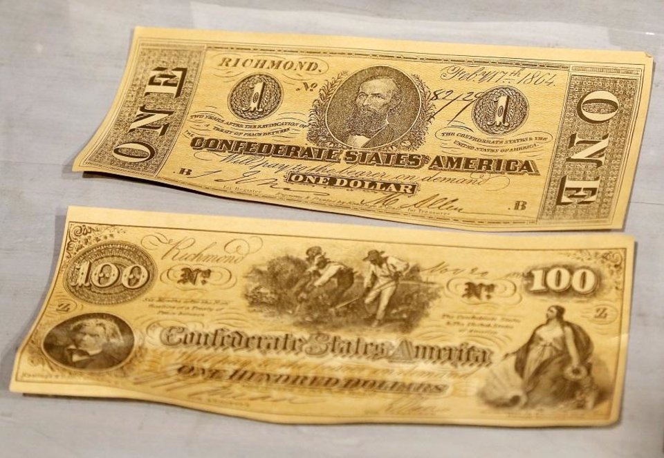 Photo - Pieces of Confederate currency are among the artwork and artifacts from around the world displayed at the Mabee-Gerrer Museum of Art Friday, Aug. 9, 2019. The Shawnee museum is celebrating its centennial in 2019. [Jim Beckel/The Oklahoman]