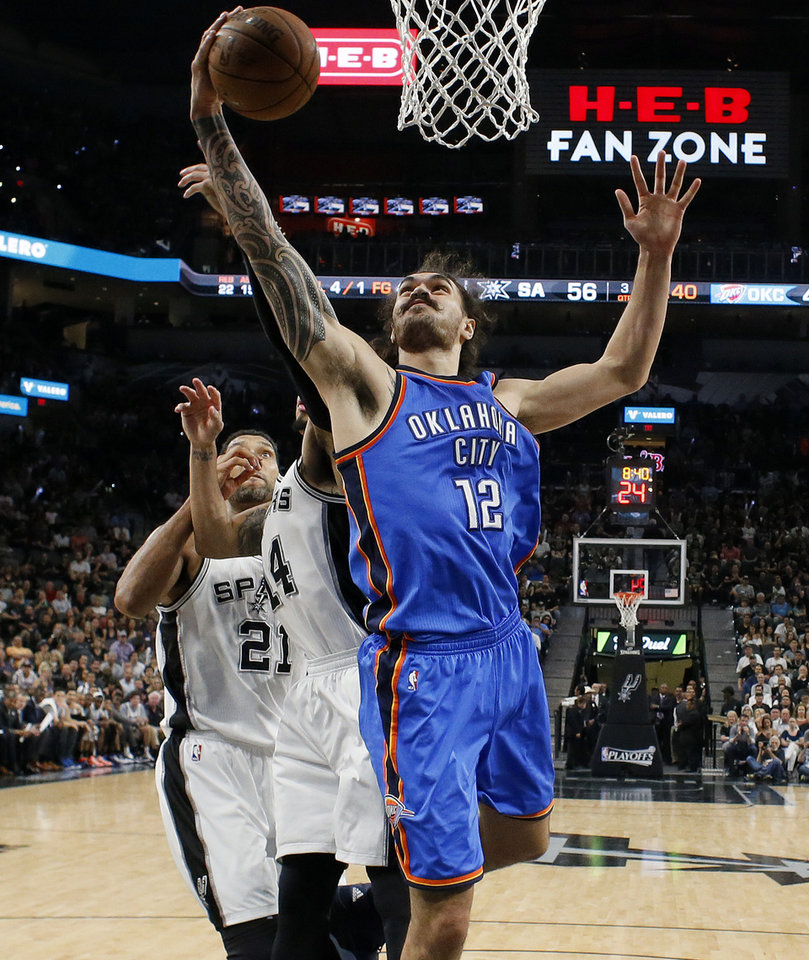 Photo - Oklahoma City's Steven Adams (12) grabs a rebound during Game 5 of the second-round series between the Oklahoma City Thunder and the San Antonio Spurs in the NBA playoffs at the AT&T Center in San Antonio, Tuesday, May 10, 2016. Oklahoma City won 95-91. Photo by Bryan Terry, The Oklahoman